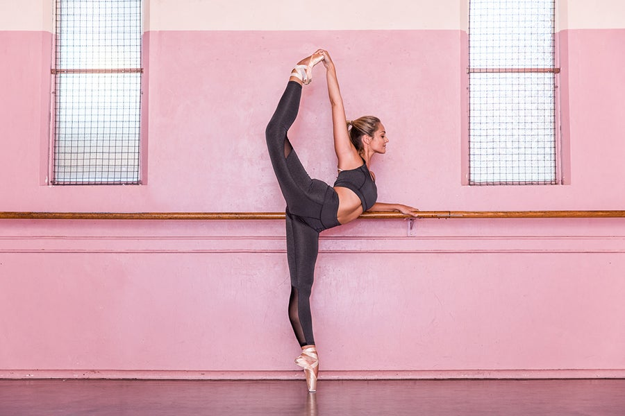 Girl doing ballet pose in studio